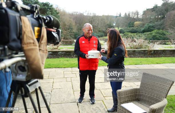 Eddie Jones head coach of England is presented with a birthday cake by Sky Sports presenter Gail Davis during England media access at Pennyhill Park...
