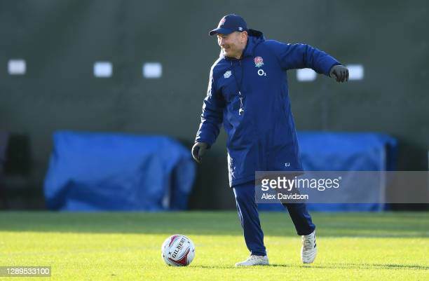 Eddie Jones, Head coach of England kicks a football during a training session ahead of their Autumn Nations Cup match against France at The Lensbury...