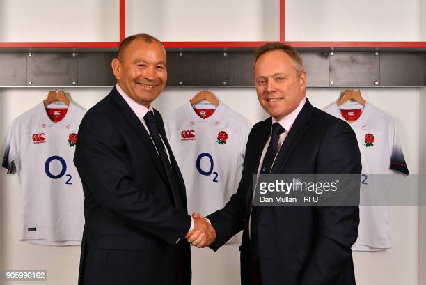 Eddie Jones Head Coach of England poses with Steve Brown Rugby Football Union Chief Executive Officer after signing a contract extension through to...