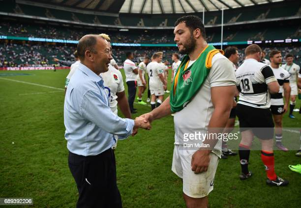 Eddie Jones Head Coach of England shakes hands with Ellis Genge of England following the Old Mutual Wealth Cup match between England and The...