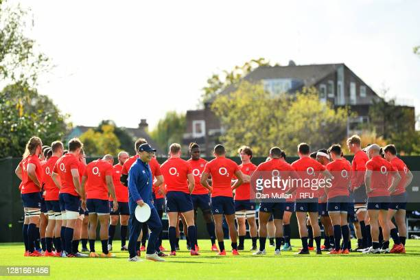Eddie Jones Head Coach of England smiles as his team gather together during a training session at The Lensbury on October 22 2020 in Teddington...