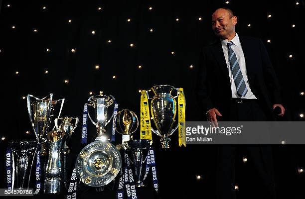Eddie Jones Head Coach of England stands alongside a collection of Rugby trophies during the Rugby Union Writers' Club Annual Dinner Awards on...