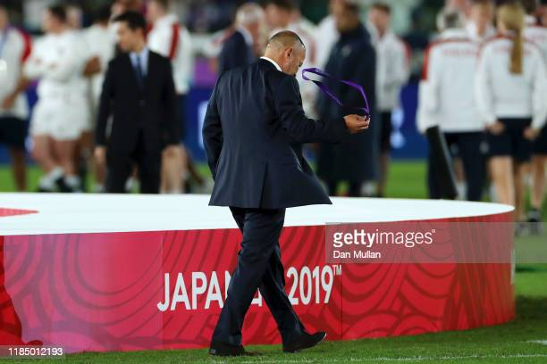 Eddie Jones Head Coach of England takes off his medal after defeat in the Rugby World Cup 2019 Final between England and South Africa at...