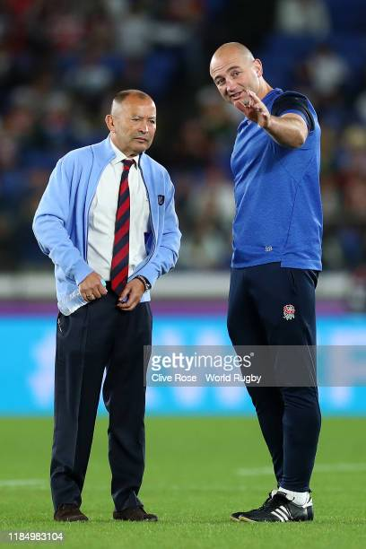Eddie Jones Head Coach of England talks to England Forwards Coach Steve Borthwick prior to the Rugby World Cup 2019 Final between England and South...