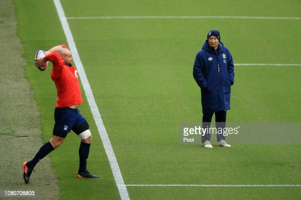 Eddie Jones Head Coach of England watches Tom Dunn taking a throwin during an England rugby training session at Twickenham Stadium on October 17 2020...