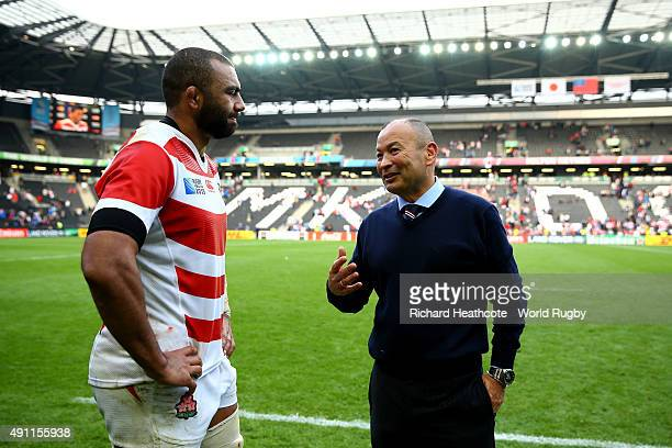 Eddie Jones Head Coach of Japan celebrates with Japan captain Michael Leitch after the 2015 Rugby World Cup Pool B match between Samoa and Japan at...