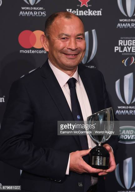 Eddie Jones of England poses with the World Rugby via Getty Images Coach of the Year Award during the World Rugby via Getty Images Awards 2017 in the...