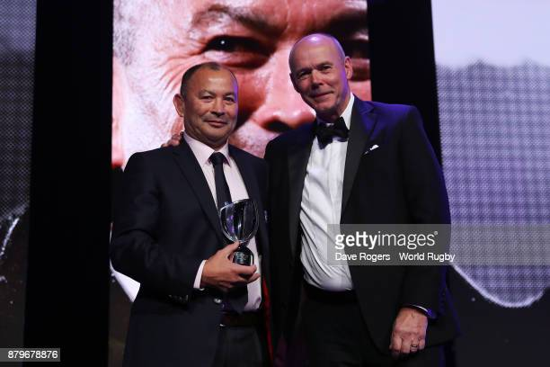 Eddie Jones of England receives the World Rugby Coach of the Year Award from Sir Clive Woodward during the World Rugby Awards 2017 in the Salle des...