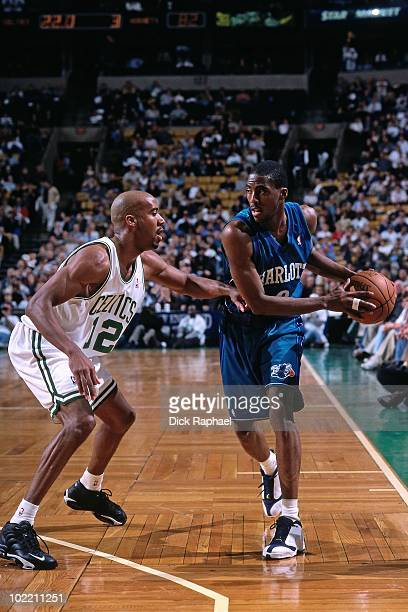 Eddie Jones of the Charlotte Hornets looks to make a move against Bruce Bowen of the Boston Celtics during a game played in 1999 at the Boston Garden...