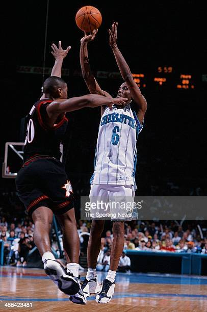 Eddie Jones of the Charlotte Hornets puts a shot up over Eric Snow of the Philadelphia 76ers during the game on May 4 1999 at Charlotte Coliseum in...