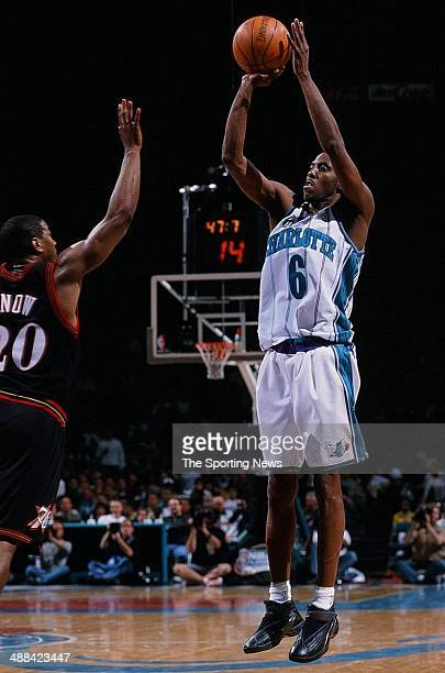 Eddie Jones of the Charlotte Hornets shoots over Eric Snow of the Philadelphia 76ers during Game One of the Eastern Conference Quarterfinals on April...