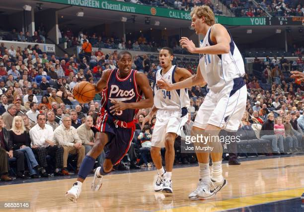 Eddie Jones of the Memphis Grizzlies drives to the basket against Devin Harris and Dirk Nowitzki of the Dallas Mavericks on December 9 2005 at...