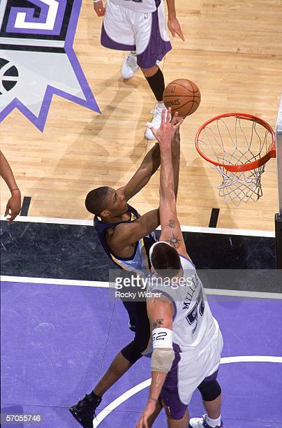 Eddie Jones of the Memphis Grizzlies takes the ball to the basket against Brad Miller of the Sacramento Kings during the game at Arco Arena on...