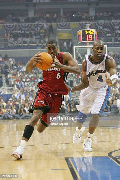 Eddie Jones of the Miami Heat drives to the basket against Antawn Jamison of the Washington Wizards in Game three of the Eastern Conference...
