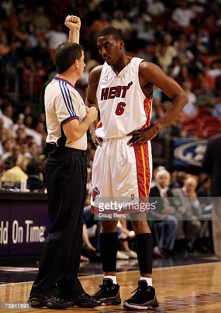 Eddie Jones of the Miami Heat questions a foul call by official Tim Donaghy while taking on the Charlotte Bobcats at American Airlines Arena April 8,...