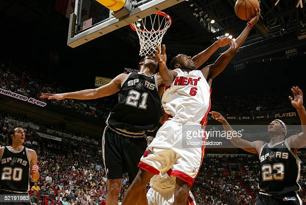 Eddie Jones of the Miami Heat shoots against Tim Duncan of the San Antonio Spurs on February 13 2005 at American Airlines Arena in Miami Florida NOTE...