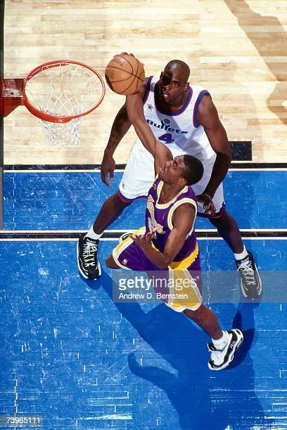 Eddie Jones of the Western Conference shoots against Chris Webber of the Eastern Conference during the 1997 AllStar Game on February 9 1997 at Gund...