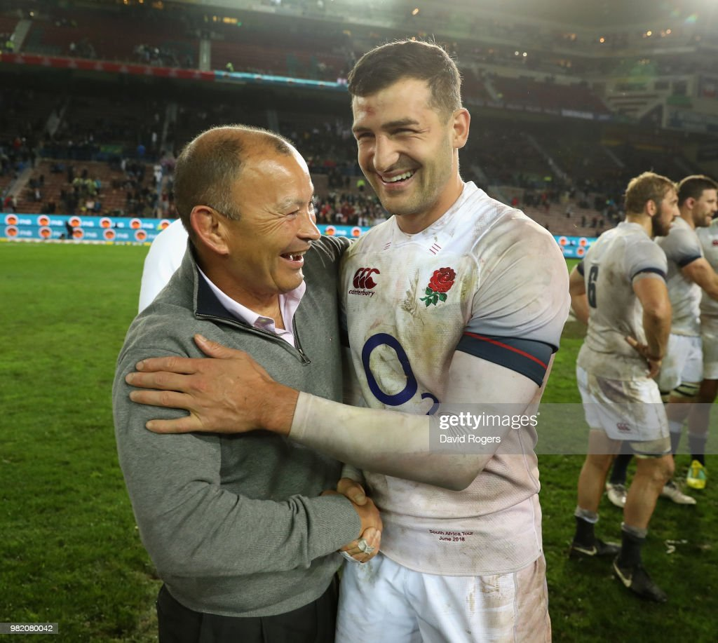 Eddie Jones, (L) the England head coach celebrates wtih try scorer Jonny May after their victory during the third test match between South Africa and England at Newlands Stadium on June 23, 2018 in Cape Town, South Africa.