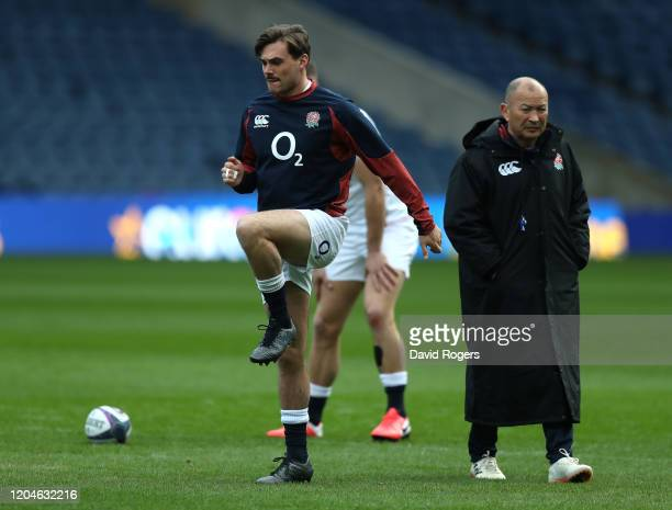 Eddie Jones the England head coach looks on as George Furbank warms up during the England captain's run at Murrayfield on February 07 2020 in...