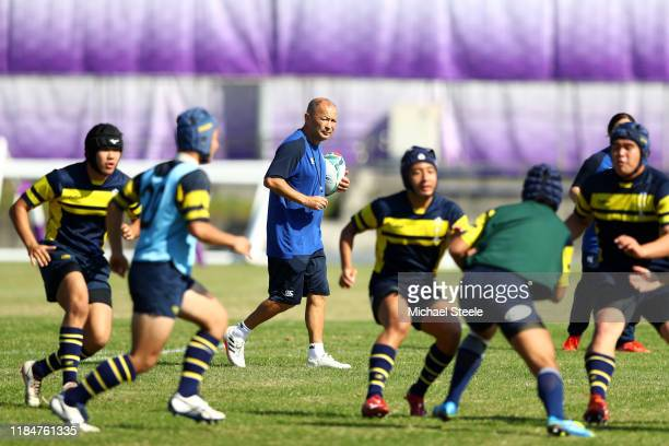 Eddie Jones the England Head Coach looks on during a coaching session with local junior players following the England Captain's Run at Fuchu Asahi...