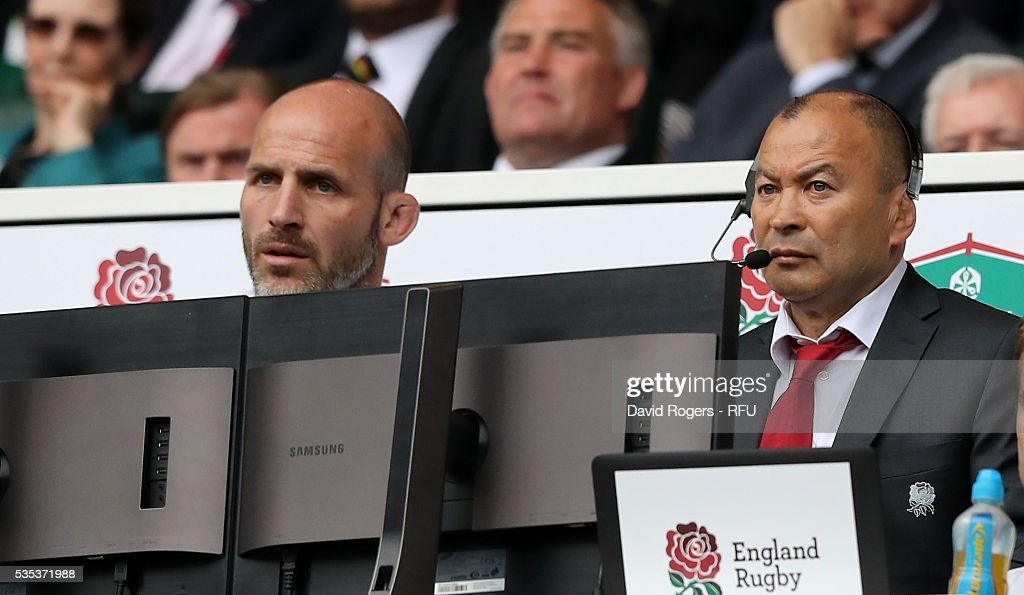 Eddie Jones, (R) the England head coach looks on with defence coach Paul Gustard during the England v Wales International match at Twickenham Stadium on May 29, 2016 in London, England.