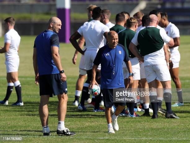 Eddie Jones the England head coach looks on with his forwards coach Steve Borthwick during the England captain's run at the Fuchu Assahi Football...