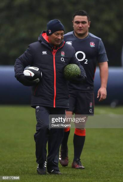 Eddie Jones the England head coach looks on with hooker Jamie George during the England training session held at Pennyhill Park on January 31 2017 in...