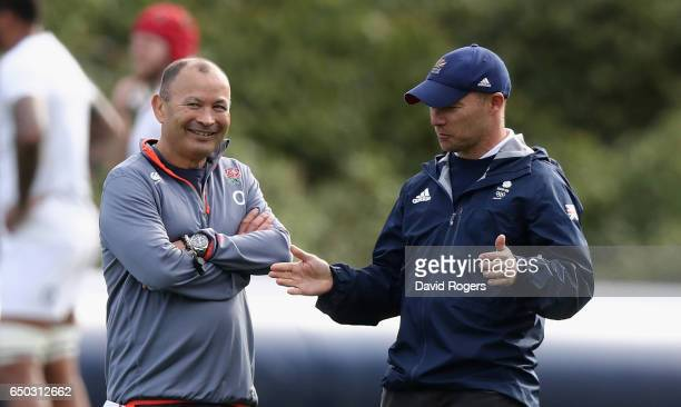 Eddie Jones the England head coach speaks to Team GB Women's Hockey coach Danny Kerry during the England training session held at Pennyhill Park on...