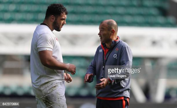 Eddie Jones the England head coach talks to Ellis Genge during the England training session held at Twickenham Stadium on February 17 2017 in London...