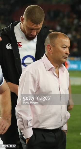 Eddie Jones the England head coach walks down the tunnel followed by Nick Isiekwe after their defeat during the first test match between South Africa...