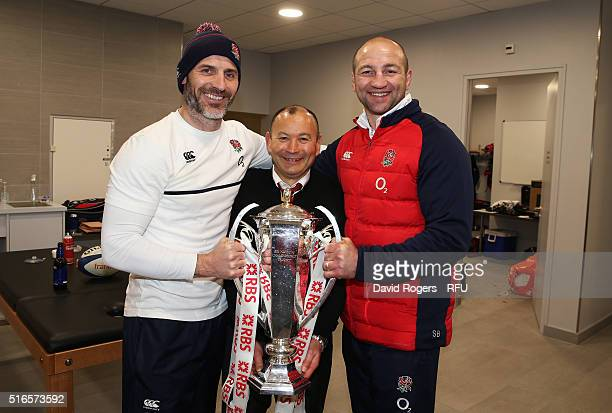 Eddie Jones the head coach of England and his assistant coaches Paul Gustard and Steve Borthwick celebrate with the trophy following their team's...