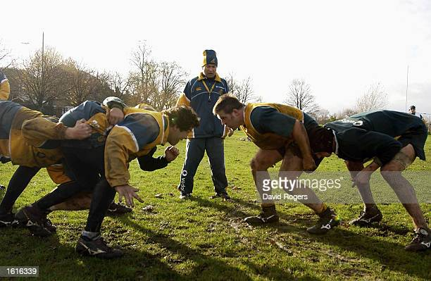 Eddie Jones the Wallaby coach watches the forward scrumaging during Australian rugby union training at St Paul's School Hammersmith London England on...