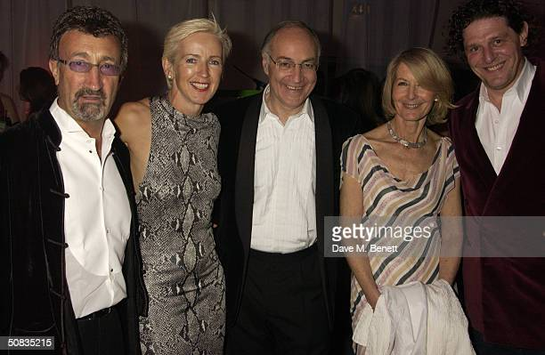 Eddie Jordan and his wife Marie Jordan Conservative leader Michael Howard and his wife Sandra Howard and Marco PierreWhite attend a London...
