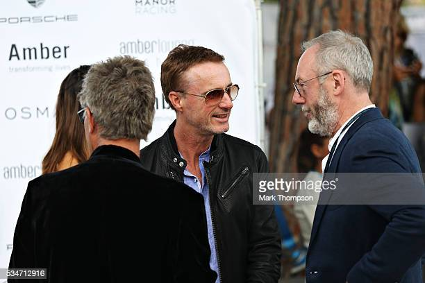 Eddie Jordan, Eddie Irvine and actor Liam Cunningham arrive at the Amber Lounge fashion show during previews to the Monaco Formula One Grand Prix at...