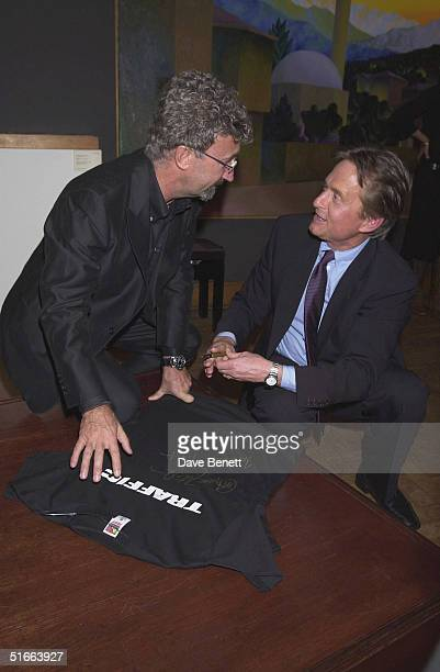 Eddie Jordan with actor Michael Douglas at the CLIC Charity Auction hosted by Eddie and Marie Jordan at Christie's on 22nd October 2001 in London