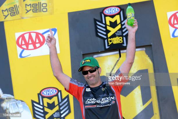 Eddie Krawiec Vance Hines HarleyDavidson NHRA Pro Stock Motorcycle is introduced to the crowd during prerace festivities before the start of the NHRA...