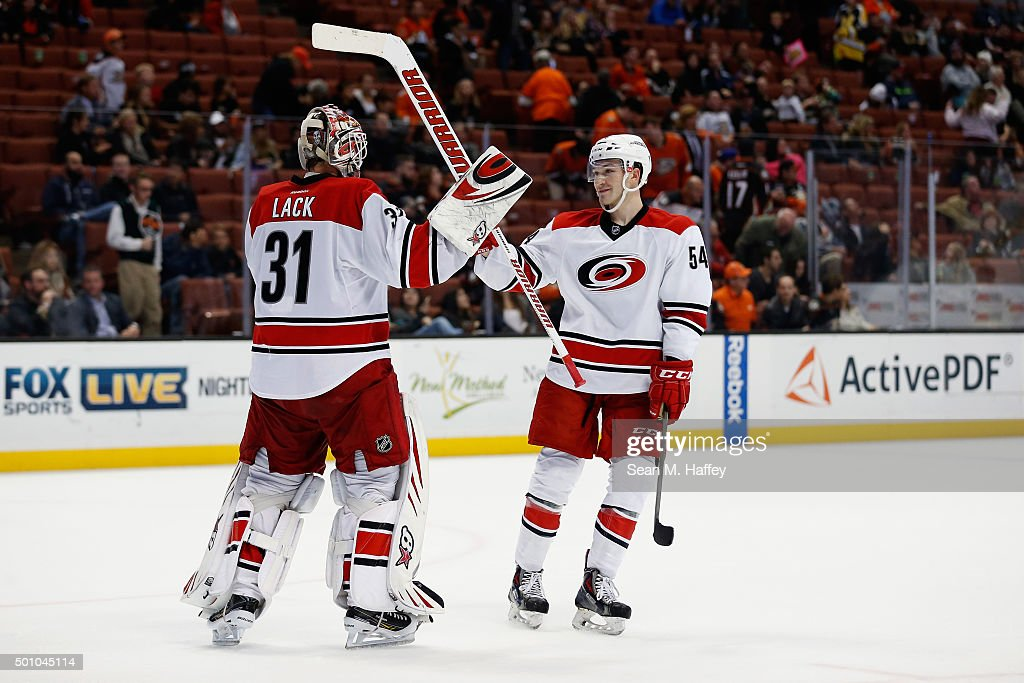 Eddie Lack #31 of the Carolina Hurricanes is hugged by Brett Pesce #54 of the Carolina Hurricanes after a game against the Anaheim Ducks at Honda Center on December 11, 2015 in Anaheim, California. The Carolina Hurricanes defeated the Anaheim Ducks 4-1.