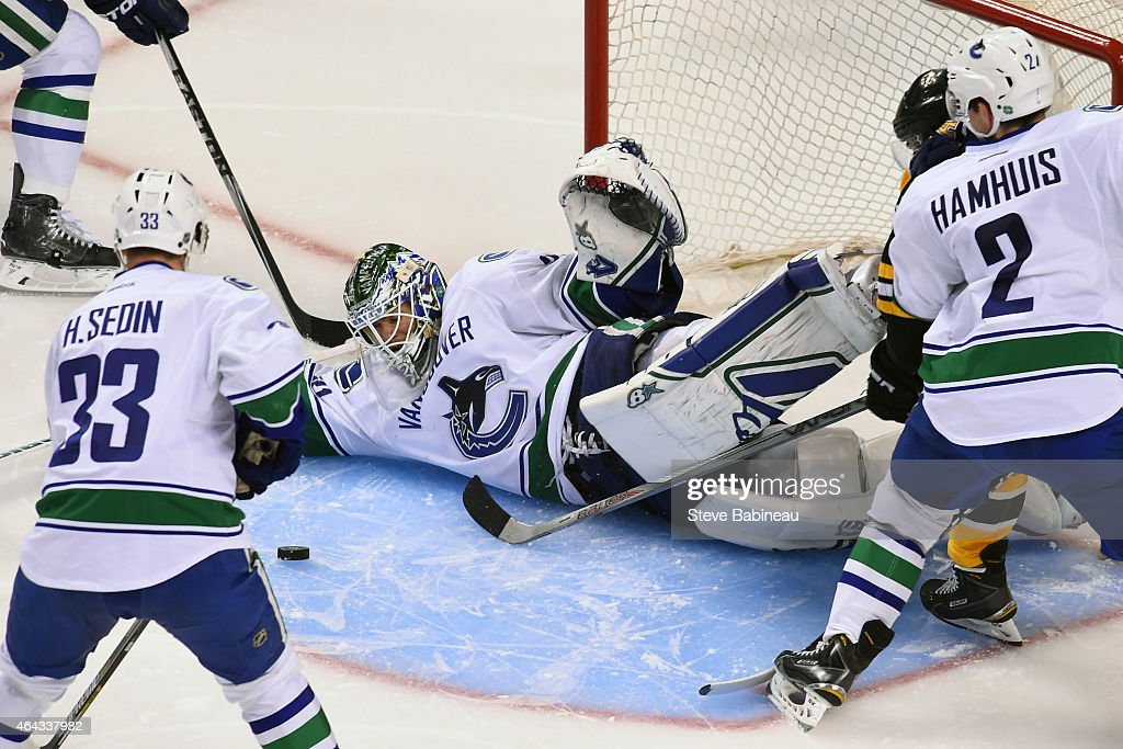 Eddie Lack #31 of the Vancouver Canucks makes a save against the Boston Bruins at the TD Garden on February 24, 2015 in Boston, Massachusetts.