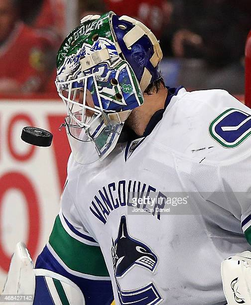 Eddie Lack of the Vancouver Canucks makes a save against the Chicago Blackhawks at the United Center on April 2 2015 in Chicago Illinois