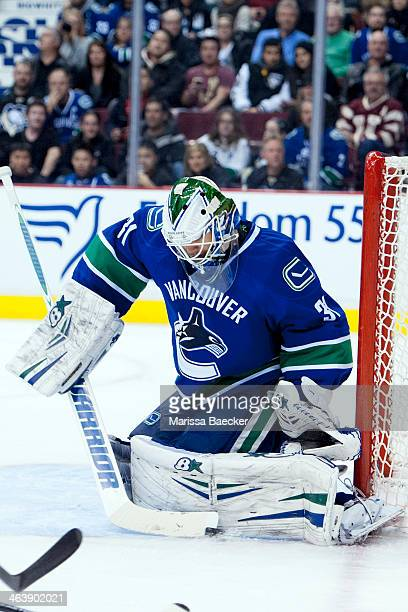 Eddie Lack of the Vancouver Canucks makes a save against the Pittsburgh Penguins on January 7, 2014 at Rogers Arena in Vancouver, British Columbia,...