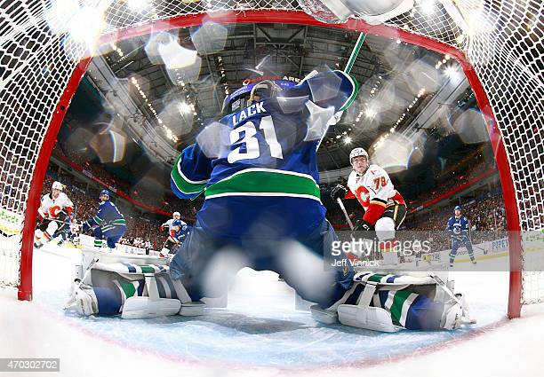 Eddie Lack of the Vancouver Canucks makes a save off the shot of Michael Ferland of the Calgary Flames during Game Two of the Western Conference...