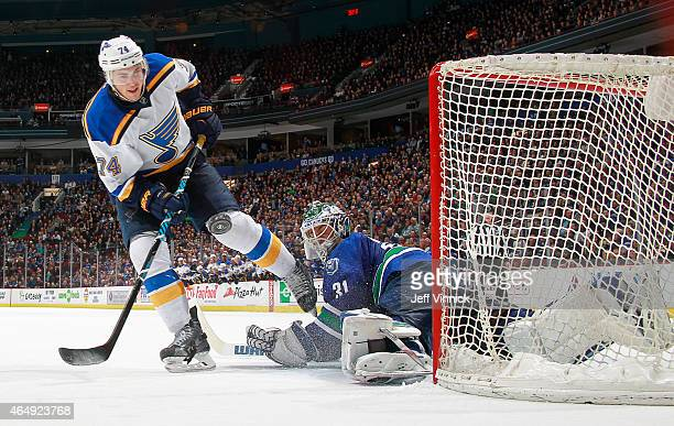 Eddie Lack of the Vancouver Canucks makes a shootout save on TJ Oshie of the St Louis Blues during their NHL game at Rogers Arena March 1 2015 in...