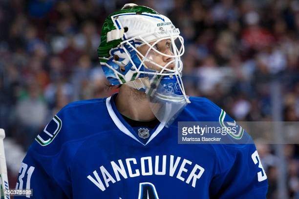 Eddie Lack of the Vancouver Canucks watches the replay against the Pittsburgh Penguins on January 7, 2014 at Rogers Arena in Vancouver, British...