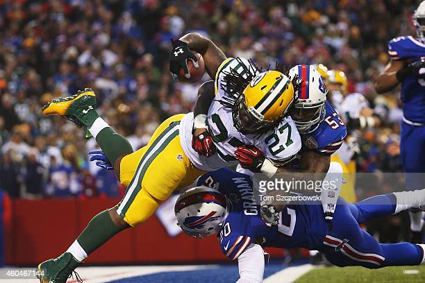 Eddie Lacy of the Green Bay Packers attempts to run a fumble recovery out of the endzone resulting in a safety during the second half against the...