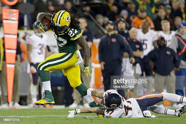 Eddie Lacy of the Green Bay Packers avoids the tackle from Chris Conte of the Chicago Bears during the second half of play at Lambeau Field on...