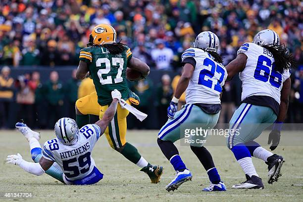 Eddie Lacy of the Green Bay Packers carries the football against the Dallas Cowboys during the 2015 NFC Divisional Playoff game at Lambeau Field on...