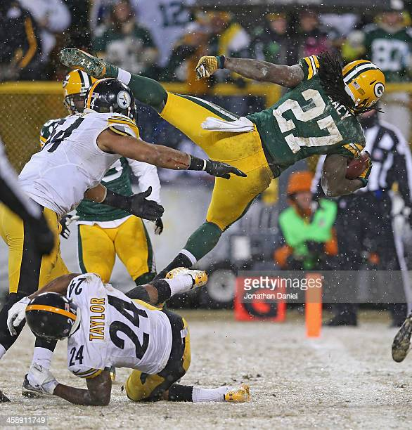 Eddie Lacy of the Green Bay Packers dives into the end zone for a touchdown over Chris Carter and Ike Taylor of the Pittsburgh Steelers at Lambeau...