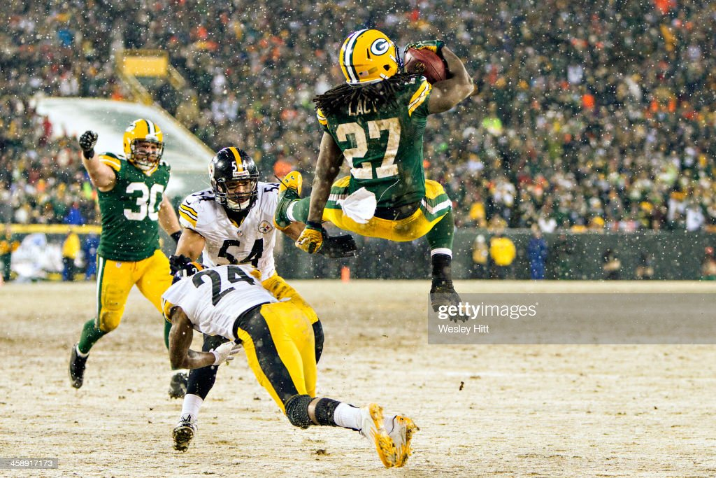 Eddie Lacy #27 of the Green Bay Packers dives through the air into the end zone for a touchdown against the Pittsburgh Steelers at Lambeau Field on December 22, 2013 in Green Bay, Wisconsin.