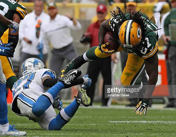 Eddie Lacy of the Green Bay Packers is upended by Glover Quin of the Detroit Lions at Lambeau Field on September 25 2016 in Green Bay Wisconsin