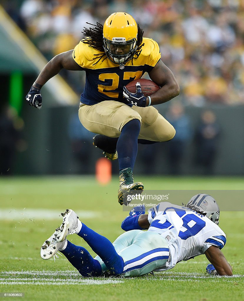Eddie Lacy #27 of the Green Bay Packers leaps over Brandon Carr #39 of the Dallas Cowboys during the third quarter at Lambeau Field on October 16, 2016 in Green Bay, Wisconsin. The Dallas Cowboys defeated the Green Bay Packers 30-16.